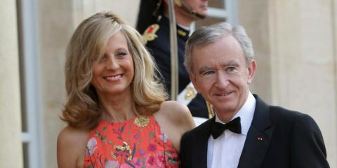 The French billionaire Bernard Arnault and his wife, Hélène Mercier, at the Élysée Palace in June 2014. His family and their conglomerate, LVMH, have pledged 200 million euros to help the Notre-Dame reconstruction.