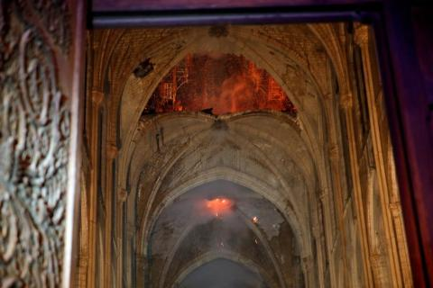 The glow of flames could still be seen inside of the cathedral early on Tuesday.