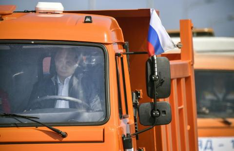 Putin drives a Kamaz truck at the opening of the Kerch Bridge in 2018. Hackers partially disabled nearby ships' navigation systems during the event.