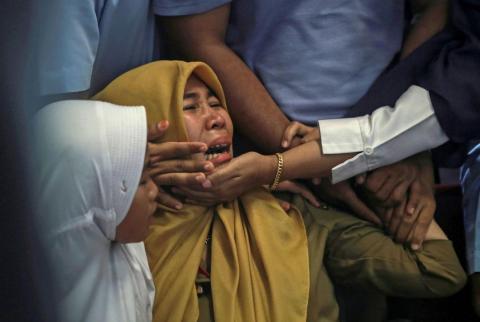 Relatives of passengers on the fatal Lion Air flight cry at Depati Amir Airpor, Pangkal Pinang, Belitung island, Indonesia.