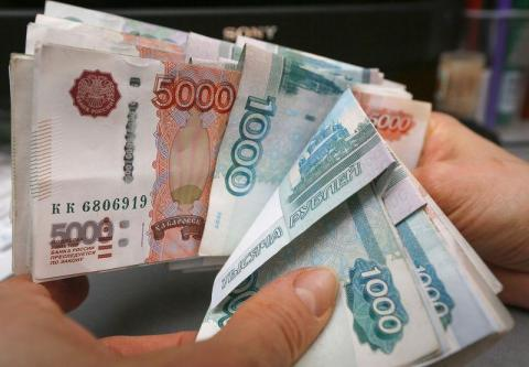 Russia's currency, the ruble, has dropped in value by 50% this decade