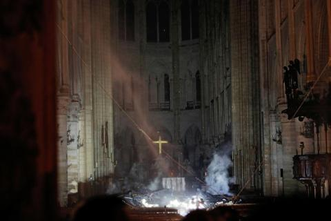 Smoke is seen inside of the cathedral's nave.