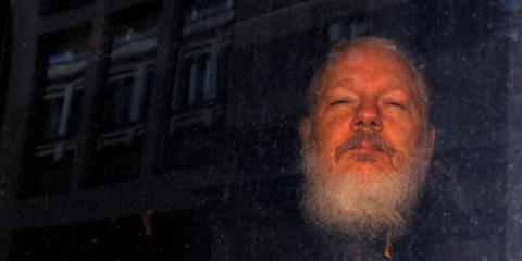 WikiLeaks founder Julian Assange is seen as he leaves a police station in London on April 11, 2019.