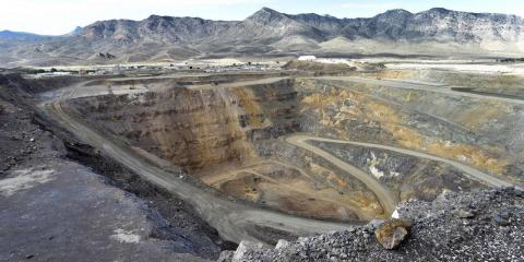 A 500-foot deep open-pit mine at Molycorp's rare-earth facility in Mountain Pass, California, in June 2015.