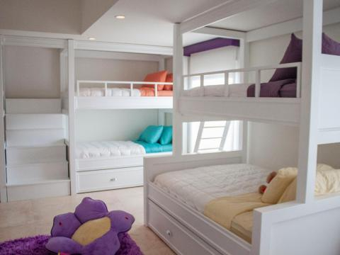 And a downstairs bedroom is arranged as a children's slumber-party room, with several bunk beds.