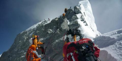 Climbers walk past the Hillary Step while pushing for Everest's summit in 2009.