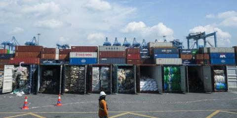 Containers filled with plastic waste seen Tuesday in Port Klang, Malaysia, before being sent back to the country of origin.