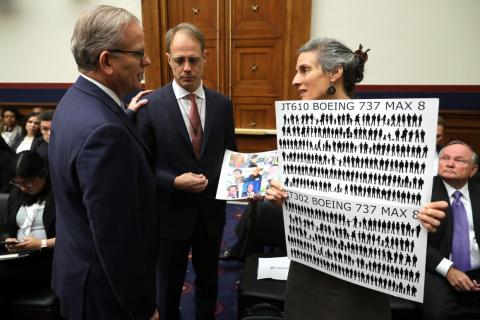 Daniel Elwell, acting administrator of the Federal Aviation Administration, talks to the parents of Ethiopian Air crash victim Samya Stumo before the House Transportation Committee holds a hearing on the Boeing 737 Max.