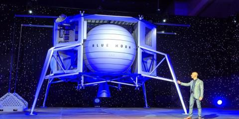 "Jeff Bezos unveils a model of Blue Origin's ""Blue Moon"" lunar lander on May 9, 2019, in Washington DC."
