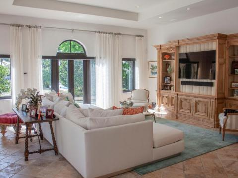 Just off the kitchen is a family room that opens up to the backyard and pool area.