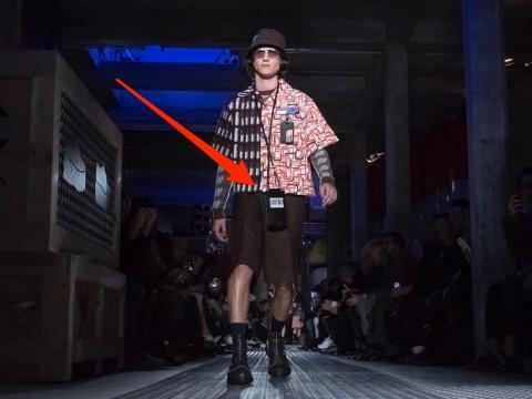 A model walks the runway at the Prada show during Milan Men's Fashion Week Fall/Winter 2018/19.