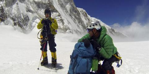 Nepalese Sherpas rest on their way to climb Everest.