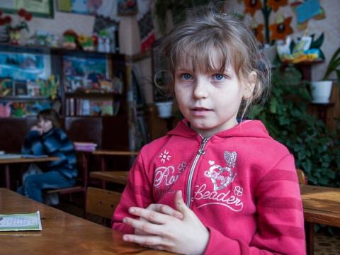Nine-year-old Olesya Petrova lives in Zalyshany and told the AP that she often goes without lunch. She's fond of scrounging for berries and other tidbits in the forest, despite the potential radiation ingestion.