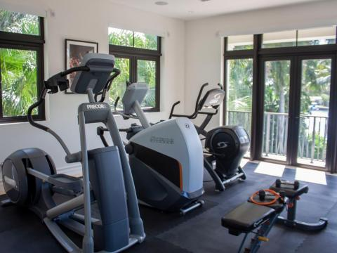 One sunny room is set up as a home gym, but it could also be turned into another bedroom.