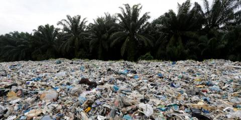 Plastic waste piled outside an illegal recycling factory in Jenjarom, in Malaysia's Kuala Langat district, on October 14.
