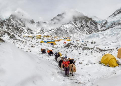 Professional guides are the backbone that has made the adventure accessible. Sherpas set up ropes and ladders, and base camps with tents, stoves, bottled oxygen, and food.