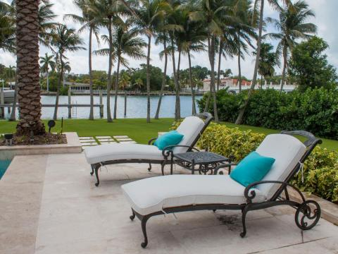 Several lounge chairs are scattered throughout the pool area.