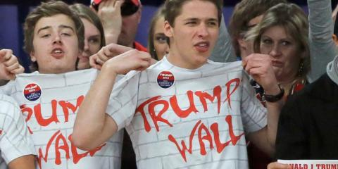 "Supporters chanting ""build that wall"" at a rally for then-Republican presidential candidate Trump in Rothschild, Wisconsin, in April 2016."