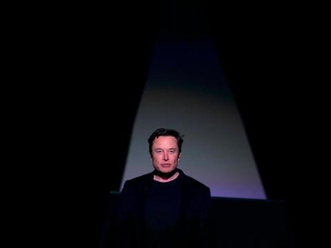 Tesla CEO Elon Musk entering the stage to introduce the Model Y at the company's design studio on March 14 in Hawthorne, California.