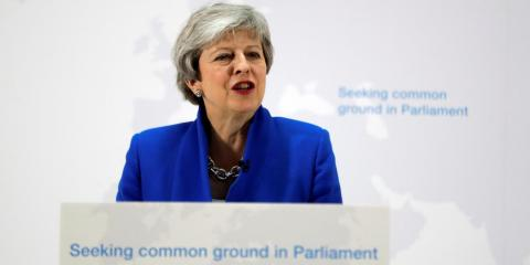 Theresa May offers MPs second referendum vote if they back her Brexit bill