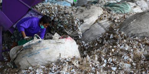 A worker sorting recyclable plastic waste at the Prabkaya Recycle Factory in Pathum Thani outside Bangkok in June 2017.