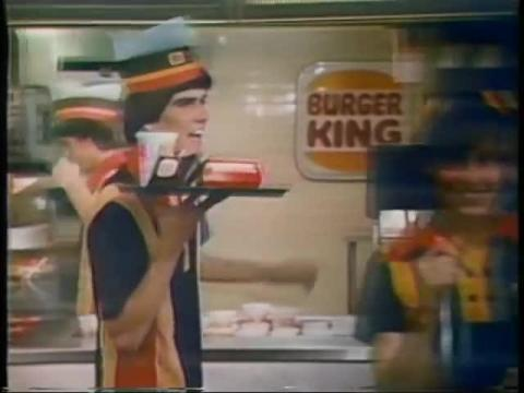 By 1979, Burger King added a dose of black and a dash of white to their uniforms. According to Machado, the 70s were a golden era of creativity when it came to the brand's uniforms.