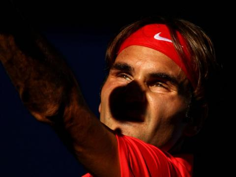 Federer still manager to serve into the sun.