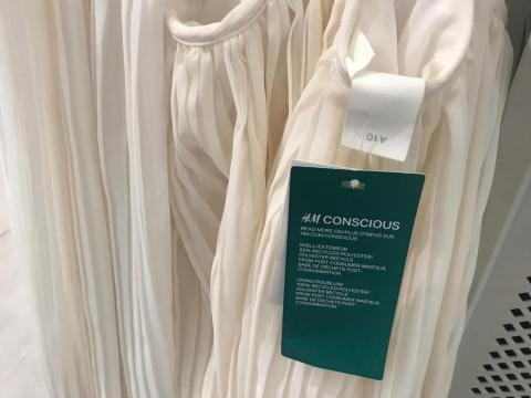 H&M has continued to build out its H&M Conscious line, a collection of eco-friendly and sustainable products made out of recycled materials. Here is an H&M Conscious tag on a dress.