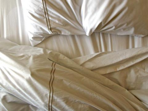 Make a pile of used linens, towels, and sheets
