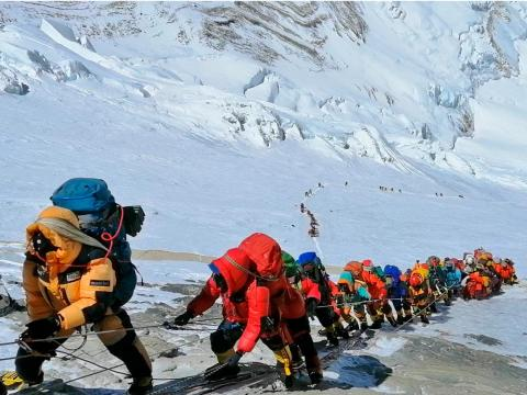 Mount Everest is clogged with inexperienced climbers, but there's too much money at stake for anyone to do anything about it