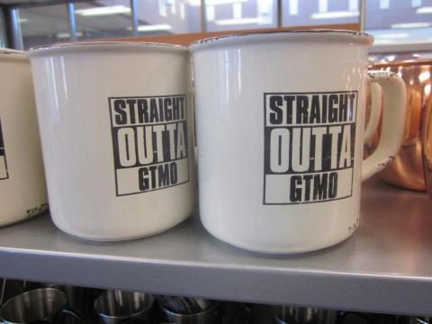 "This mug also references the base as GTMO — the US military's code name for Guantanamo Bay — playing on the 1988 NWA album ""Straight Outta Compton."""