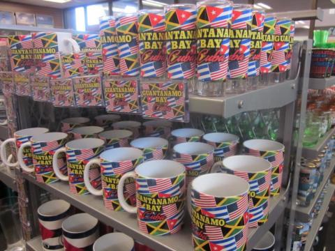 Some other mugs have the flags of the US, Cuba, and Jamaica on them — likely representing the countries whose citizens live on the base.