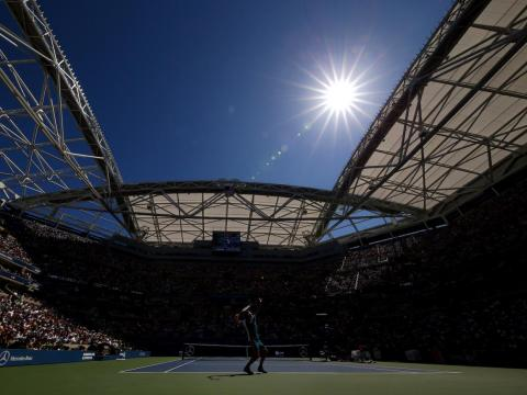 The sun beat down on Federer at the 2015 U.S. Open.