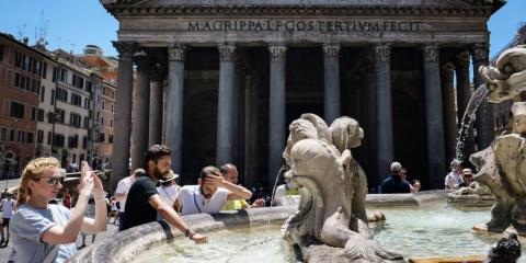 Tourists at a fountain in front of the Pantheon in Rome on Monday.