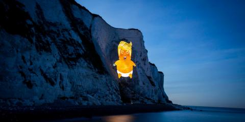 The Trump baby blimp symbol was projected onto the White Cliffs of Dover, on England's southern coast on Sunday.