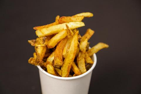 "Despite their quantity and freshness, these fries are just less satisfying — they're only sort of crispy and sort of salty. Five Guys relies too heavily on the ""real potato"" appeal of its fry at the expense of flavor. They have a"