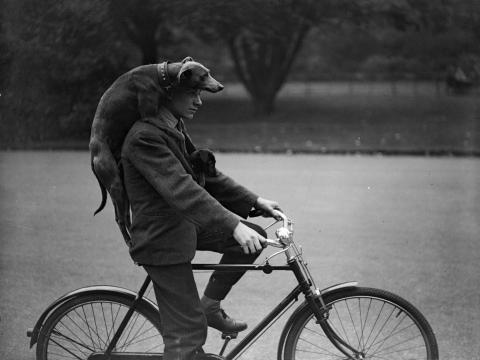 A man cycling through London's Battersea in the '30s.