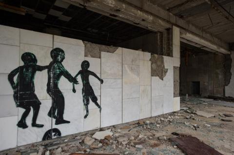 Graffiti artists drew strange shadowy figures on the walls of buildings.