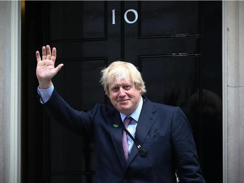 Johnson enters Downing Street as prime minister for the first time