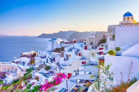 Places like Santorini, Greece, are almost too picturesque, leading to overcrowding from tourists.
