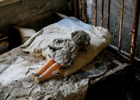 Tourists have arranged creepy dolls on abandoned beds and windowsills.