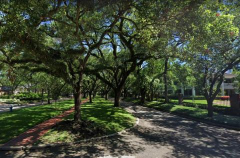 Photo-takers are drawn to Houston's Broadacres neighborhood, where a scenic walkway lined with trees cuts through an affluent residential area.