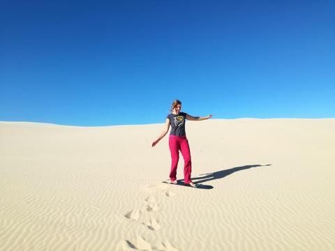 The author, Natalia Lusinski, sandboarding in New South Wales, Australia.