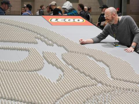 "LEGO ""Star Wars"" design director Jens Kronvold Frederiksen places a final piece on the largest display of LEGO ""Star Wars"" minifigures at ""Star Wars"" Celebration in April in Chicago."
