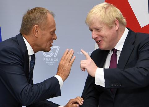 Donald Tusk y Boris Johnson durante la cumbre del G7.