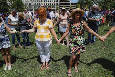 Mourners at a vigil following the mass shooting in Dayton.