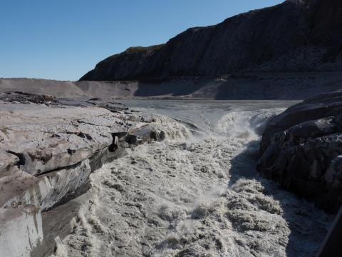 Ice melt forms gushing white water in Kangerlussuaq, Greenland on August 1, 2019.