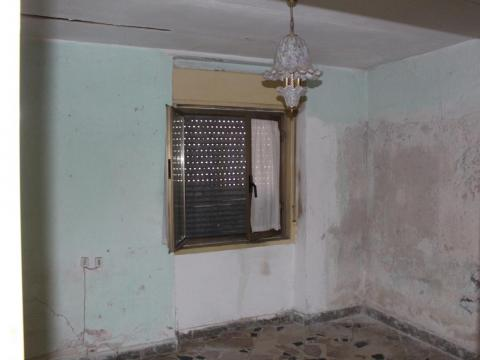 It would take a lot of work to restore this living room back to former glory.