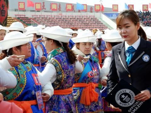 A Guinness World Records adjudicator at the wine-toasting event in Haidong, Qinghai, China.