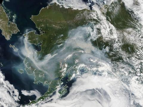 NASA's Aqua satellite captured thick wildfire smoke swirling over Alaska on July 8, 2019.